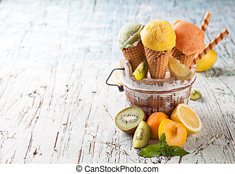 Fresh ice cream scoops in cones on wood - Studio photo of...