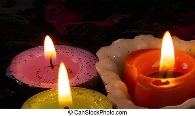 Candles and Dry Leaves on the Water