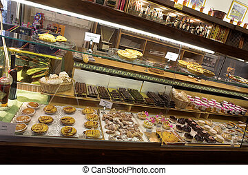 Patisserie in France - All kinds of pastries on shelves in...