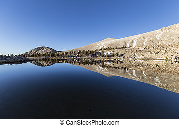 Cirque Lake Reflection - Calm water and mirror like...