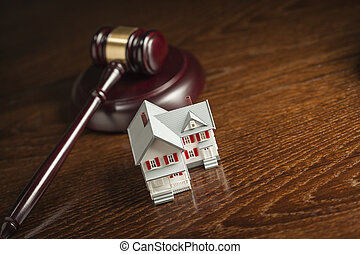 Gavel and Small Model House on Table - Gavel and Small Model...