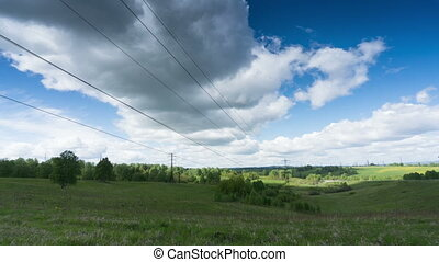 Power Lines - View of a power line with clouds floating over...