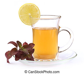 Cup of herbal tea with red tulsi leaves and lemon over white...