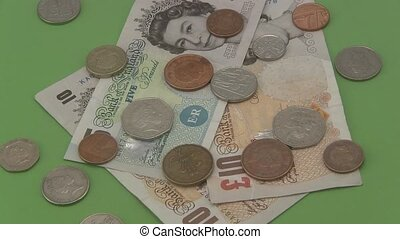Sterling UK cash and coins - Close up of sterling UK cash...