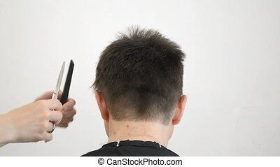 Men's haircut - Man gets a haircut on white background