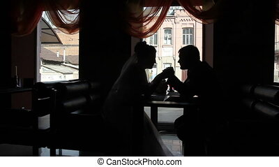 bride and groom in a cafe in backlit