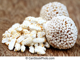 Bangladeshi Sweets and puffed rice over white background