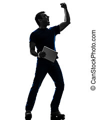 man holding digital tablet  silhouette