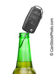 Car key in neck of bottle of bee - studio shot over white -...