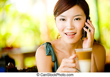 Woman Drinking Coffee - A young woman enjoying breakfast...