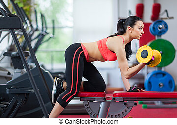 Sport woman exercising gym, fitness center - Woman in gym...