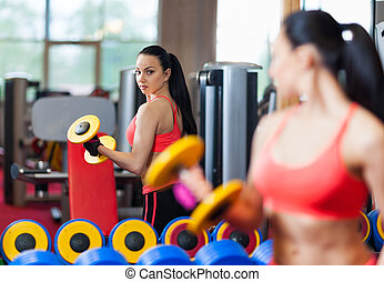 Sport woman exercising gym, fitness center - Woman...