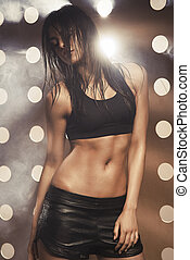 portrait of young fitness woman on background