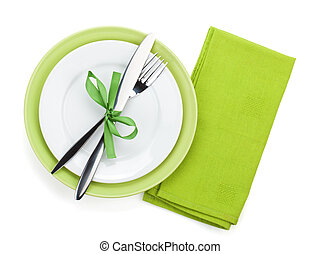 Fork with knife over towel and empty plates Isolated on...