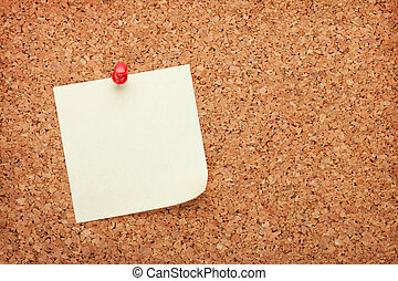 Blank postit note on cork notice board - Blank postit note...
