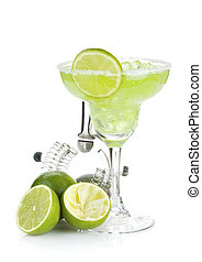 Classic margarita cocktail with salty rim, limes and drink...
