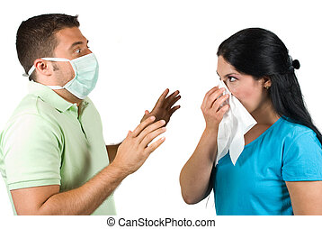 Terrified man with protective mask try to stop a sneezing...
