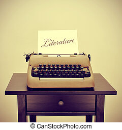literature - an old typewriter with a page with the word...