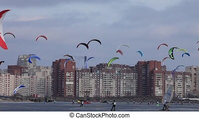colored snowkiting in the sky over