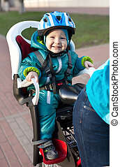 Little boy in the seat bicycle