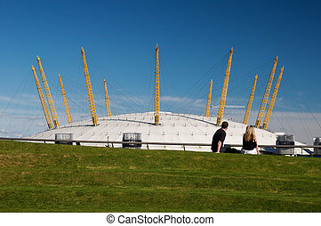Young couple at the O2 arena - Young couple relaxing and...