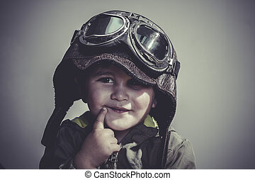 concept, fun and funny child dressed in aviator hat and...