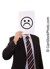 Sad Face - businessman hiding behind a paper with a sad face...