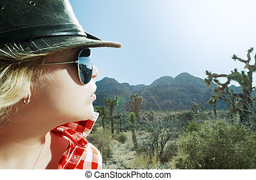 cowboy - close up portrait of nice young woman in sunglasses...