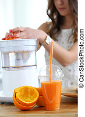 Beautiful girl making orange juice - Natural, vitamins....