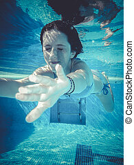 water, teenager diving into a pool