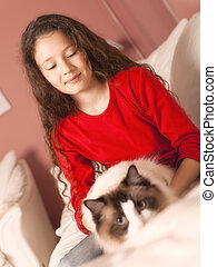 young girl with her cat