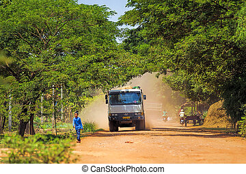 Cambodian everyday life - Truck on dusty road in Treak...