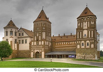 Medieval castle in town Mir in Belarus - HDR Version -...