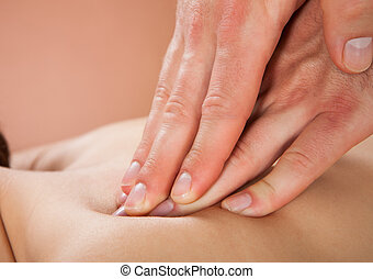 Therapist, Massaging, Female, Customer's, Back, At, Spa