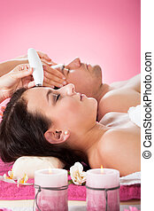 Couple Undergoing Therapies At Spa