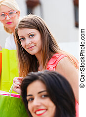 Shopping Women - Girls out in town together shopping in...