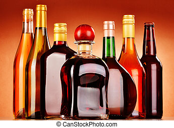Bottles of assorted alcoholic beverages including beer and...