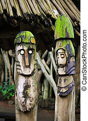 Two wooden totems idols near african village