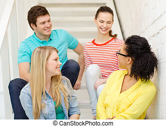 smiling teenagers hanging out - frienship and education...