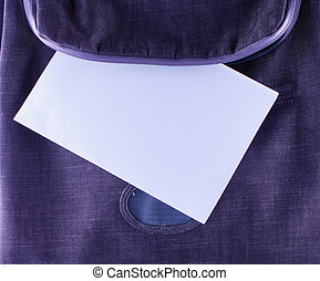 White paper in backpack