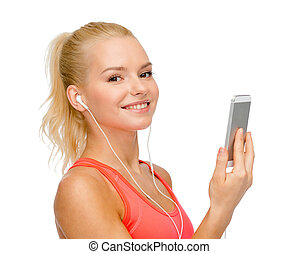 smiling sporty woman with smartphone and earphones - sport,...