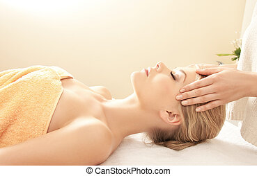 beautiful woman in massage salon - picture of calm beautiful...