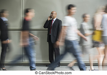 Indian Business man using a Cell Phone. - Indian Business...