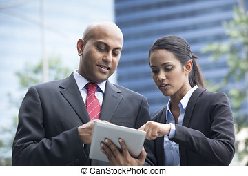Indian Business people with digital tablet - Two Indian...