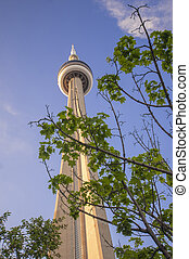 CN Tower and maple leafs - Detail of the CN Tower with maple...