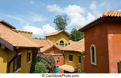view of typical vintage house with tile roof