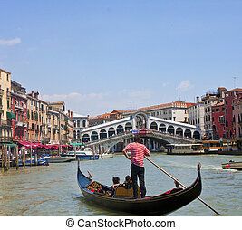 Gondola in Venice Canal - A gondola in the Grand Canal in...