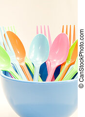 Plastic tableware consisting of spoon, fork and bowls over...