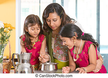 Indian family cooking - Asian family cooking food together...