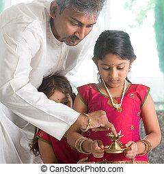 Preparing for festival of light - Indian family in...